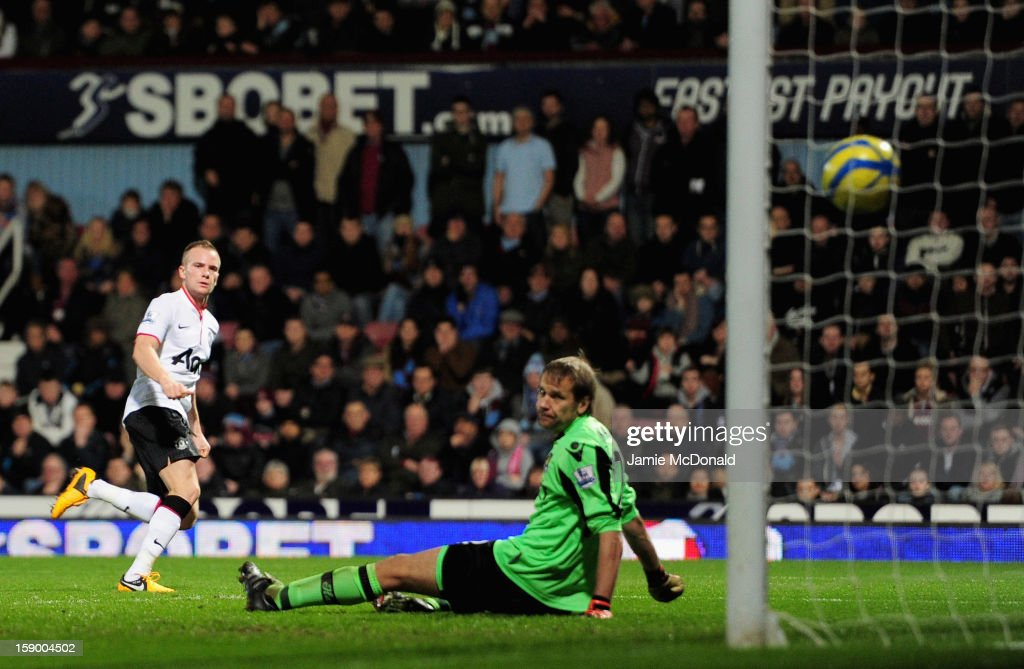 <a gi-track='captionPersonalityLinkClicked' href=/galleries/search?phrase=Tom+Cleverley&family=editorial&specificpeople=4192565 ng-click='$event.stopPropagation()'>Tom Cleverley</a> of Manchester United scores the opening goal past <a gi-track='captionPersonalityLinkClicked' href=/galleries/search?phrase=Jussi+Jaaskelainen&family=editorial&specificpeople=240728 ng-click='$event.stopPropagation()'>Jussi Jaaskelainen</a> of West Ham United during the FA Cup with Budweiser Third Round match between West Ham United and Manchester United at the Boleyn Ground on January 5, 2013 in London, England.