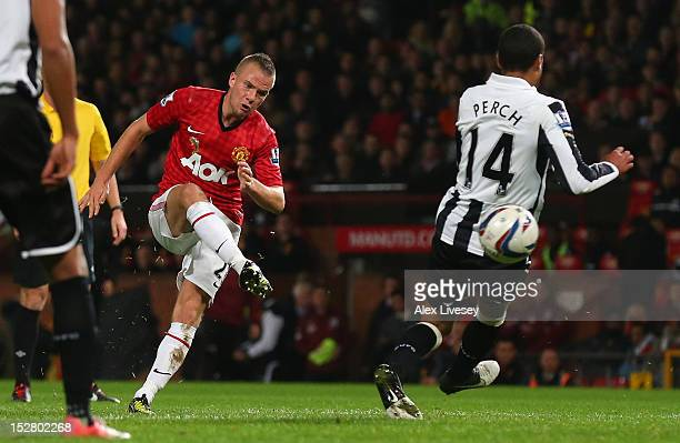 Tom Cleverley of Manchester United scores the second goal during the Capital One Cup Third Round match between Manchester United and Newcastle United...