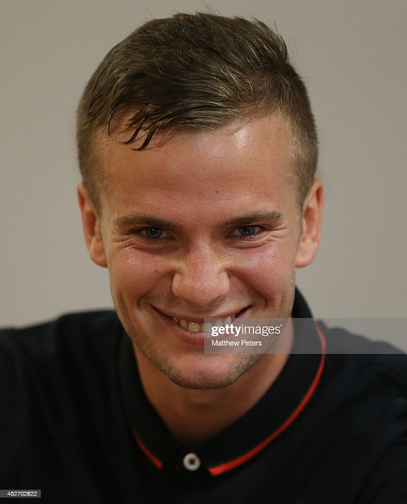 Tom Cleverley of Manchester United speaks during a press conference after an open training session as part of their pre-season tour of the United States at Sports Authority Field at Mile High on July 25, 2014 in Denver, Colorado.