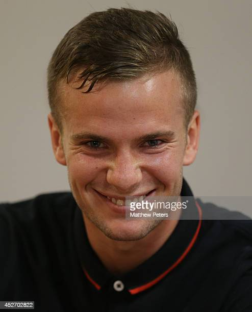 Tom Cleverley of Manchester United speaks during a press conference after an open training session as part of their preseason tour of the United...
