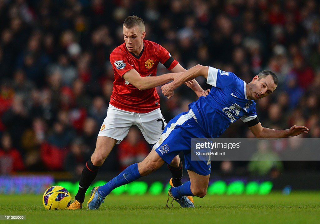 Tom Cleverley of Manchester United tangles with Leon Osman of Everton during the Barclays Premier League match between Manchester United and Everton at Old Trafford on February 10, 2013 in Manchester, England.