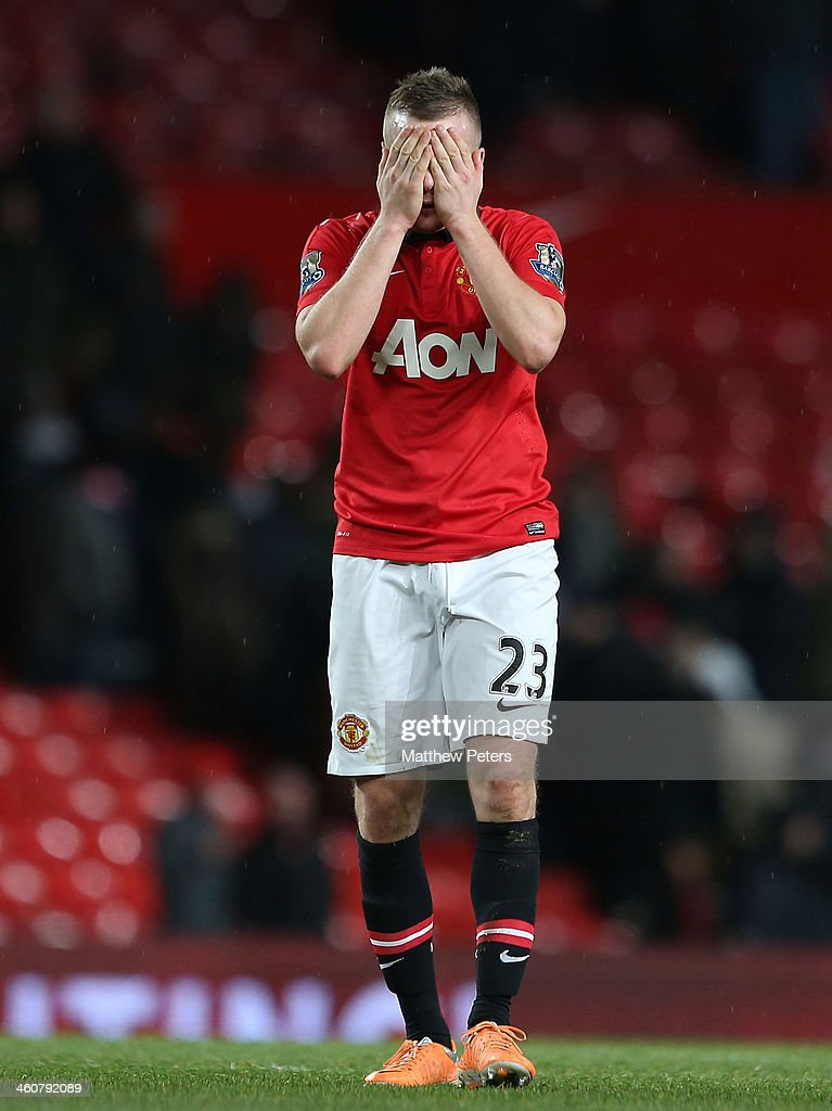 Tom Cleverley of Manchester United walks off after the FA Cup Third Round match between Manchester United and Swansea City at Old Trafford on January 5, 2014 in Manchester, England.