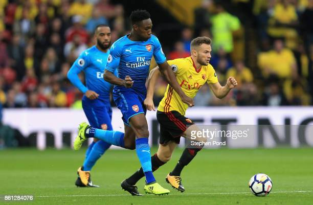 Tom Cleverley of Watford and Danny Welbeck of Arsenal in action during the Premier League match between Watford and Arsenal at Vicarage Road on...