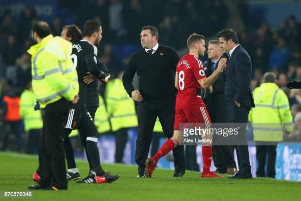 Tom Cleverley of Watford and Marco Silva Manager of Watford embrace after the Premier League match between Everton and Watford at Goodison Park on...