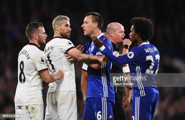 Tom Cleverley of Watford and Valon Behrami of Watford clash with John Terry of Chelsea and Willian of Chelsea during the Premier League match between...