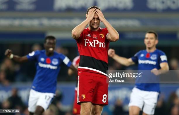 Tom Cleverley of Watford reacts to missing a penalty during the Premier League match between Everton and Watford at Goodison Park on November 5 2017...