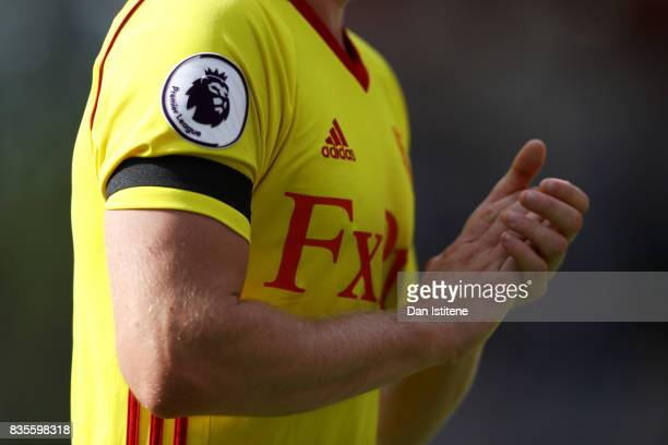 Tom Cleverley of Watford wears a black armband in tribute to the victims of the recent terrorist attacks in Catalonia Spain during the Premier League...