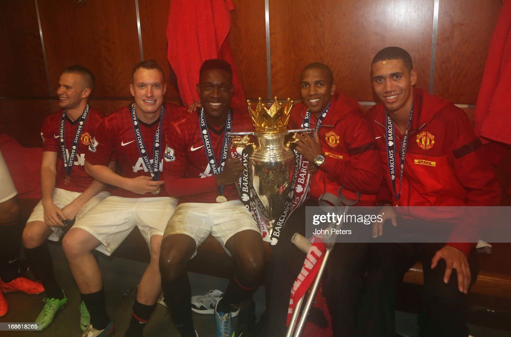 Tom Cleverley, Phil Jones, Danny Welbeck, Ashley Young and Chris Smalling of Manchester United celebrate with the Barclays Premier League trophy in the dressing room after the Barclays Premier League match between Manchester United and Swansea at Old Trafford on May 12, 2013 in Manchester, England.