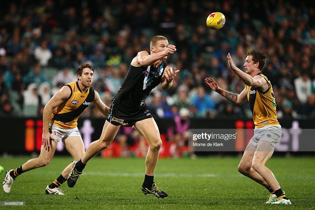 Tom Clurey of the Power passes the ball during the round 15 AFL match between the Port Adelaide Power and the Richmond Tigers at Adelaide Oval on July 1, 2016 in Adelaide, Australia.
