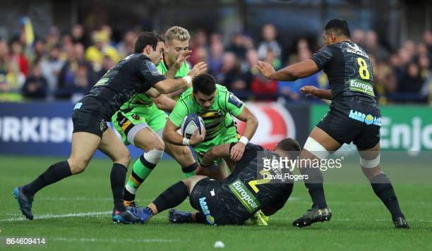 Tom Collins of Northampton is tackled by Benjamin Kayser Morgan Parra and Fritz Lee during the European Rugby Champions Cup match between ASM...