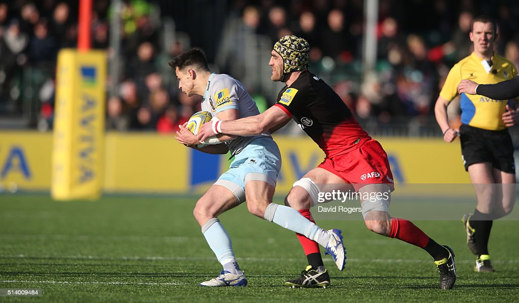Tom Collins of Northampton is tackled by <a gi-track='captionPersonalityLinkClicked' href=/galleries/search?phrase=Kelly+Brown+-+Rugby+Player&family=editorial&specificpeople=211000 ng-click='$event.stopPropagation()'>Kelly Brown</a> during the Aviva Premiership match between Saracens and Northampton Saints on March 5, 2016 in Barnet, England.