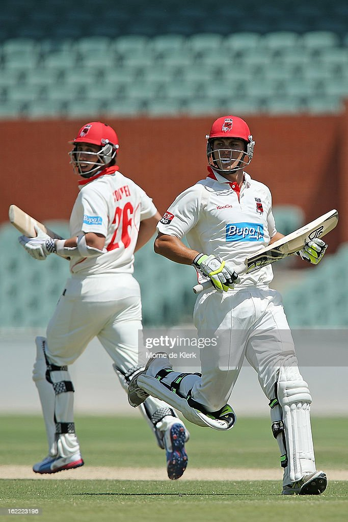 Tom Cooper and Sam Raphael (R) of the Redbacks run between the wickets during day three of the Sheffield Shield match between the South Australian Redbacks and the New South Wales Blues at Adelaide Oval on February 21, 2013 in Adelaide, Australia.