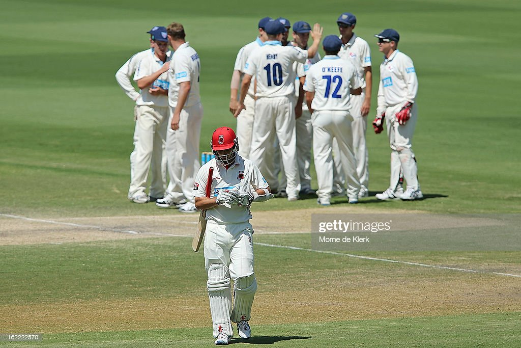 Tom Cooper of the Redbacks leaves the field after getting out during day three of the Sheffield Shield match between the South Australian Redbacks and the New South Wales Blues at Adelaide Oval on February 21, 2013 in Adelaide, Australia.