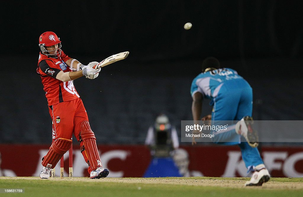 Tom Cooper of the Renegades hits a six off the bowling of <a gi-track='captionPersonalityLinkClicked' href=/galleries/search?phrase=Kemar+Roach&family=editorial&specificpeople=5408487 ng-click='$event.stopPropagation()'>Kemar Roach</a> of the Heat during the Big Bash League match between the Melbourne Renegades and the Brisbane Heat at Etihad Stadium on December 22, 2012 in Melbourne, Australia.