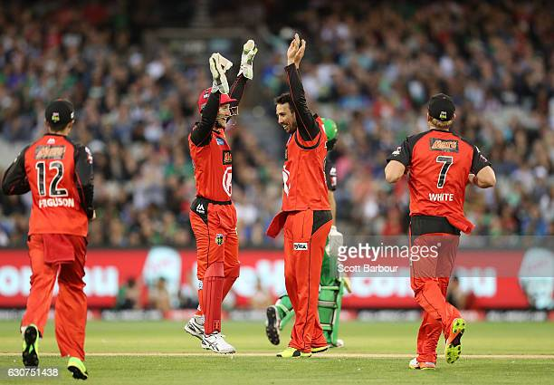 Tom Cooper of the Renegades is congratulated by his teammates after dismissing Glenn Maxwell of the Stars during the Big Bash League match between...