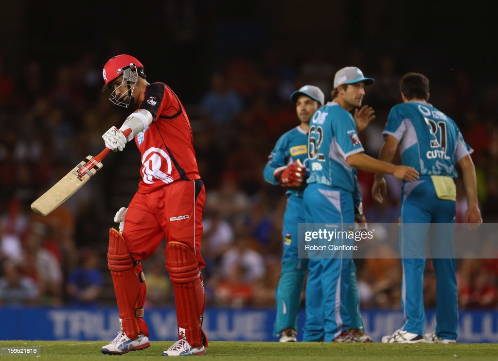 Tom Cooper of the Renegades walks from the ground after he was dismissed during the Big Bash League Semi-Final match between the Melbourne Renegades and the Brisbane Heat at Etihad Stadium on January 15, 2013 in Melbourne, Australia.
