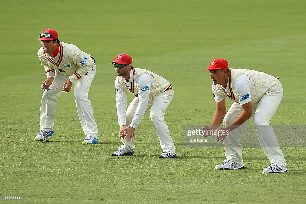 Tom Cooper, Phil Hughes and Trent Lawford of the Redbacks field in the slips during day one of the Sheffield Shield match between the Western Australia Warriors and the South Australia Redbacks at the WACA on November 6, 2013 in Perth, Australia.