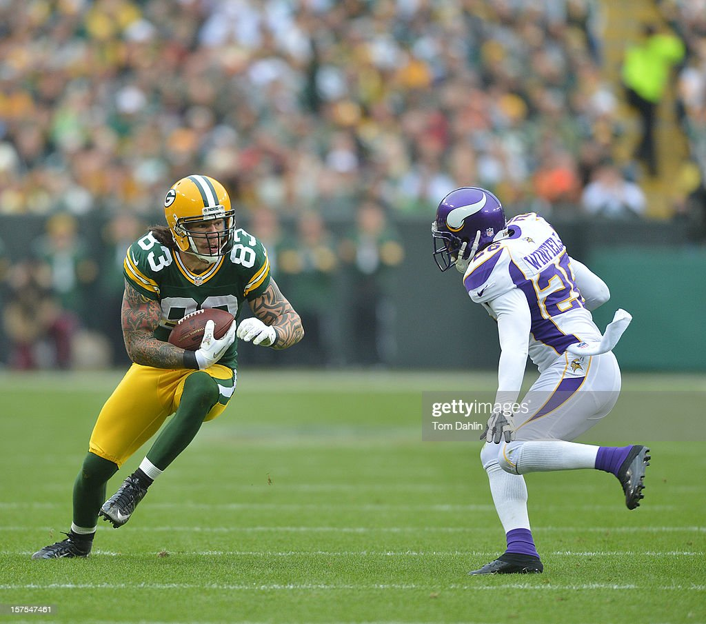 Tom Crabtree #83 of the Green Bay Packers carries the ball during an NFL game against the Minnesota Vikings at Lambeau Field on December 2, 2012 in Green Bay, Wisconsin.
