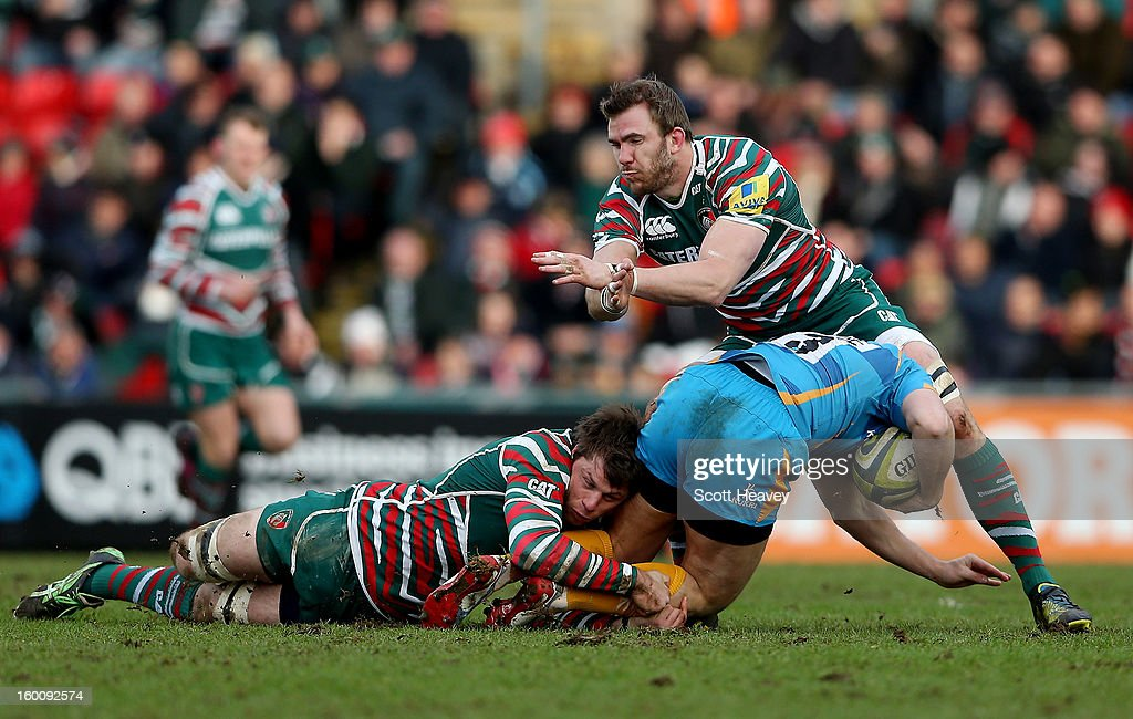 Tom Croft (R) and Brett Deacon of Leicester Tigers tackle Will Taylor of London Wasps during the LV=Cup match between Leicetser Tigers and London Wasps at Welford Road on January 26, 2013 in Leicester, England.