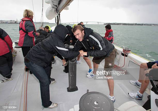 Tom Croft helps winch the sails as the England IRB Rugby World Cup 2011 squad enjoy a sailing day on exAmerica's Cup yachts on Auckland's Waitemata...