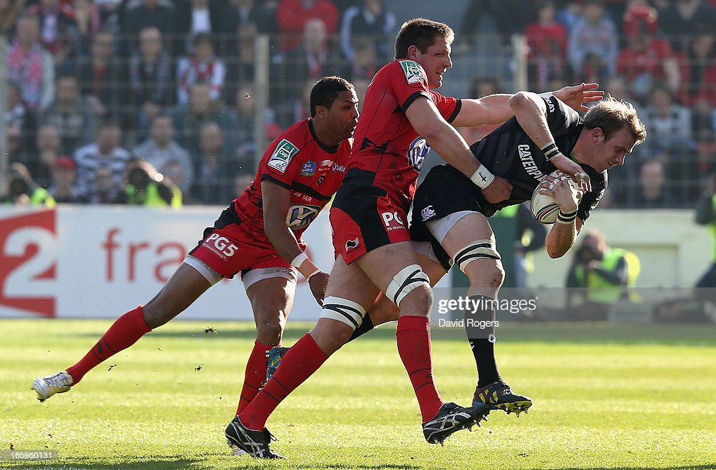 Tom Croft of Leicester is tackled by Bakkies Botha and Delon Armitage during the Heineken Cup quarter final match between Toulon and Leicester Tigers at Felix Mayol Stadium on April 7, 2013 in Toulon, France.