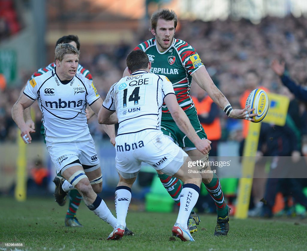 <a gi-track='captionPersonalityLinkClicked' href=/galleries/search?phrase=Tom+Croft&family=editorial&specificpeople=672626 ng-click='$event.stopPropagation()'>Tom Croft</a> of Leicester Tigers hands the ball off during the Aviva Premiership match between Leicester Tigers and Sale Sharks at Welford Road on March 2, 2013 in Leicester, England.