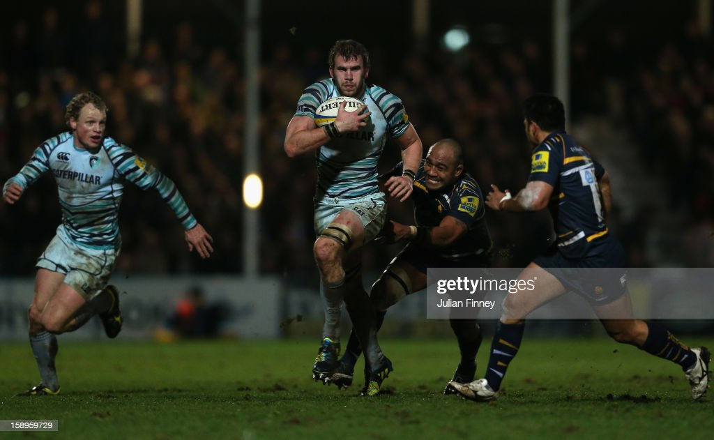 <a gi-track='captionPersonalityLinkClicked' href=/galleries/search?phrase=Tom+Croft&family=editorial&specificpeople=672626 ng-click='$event.stopPropagation()'>Tom Croft</a> of Leicester Tigers is tackled by <a gi-track='captionPersonalityLinkClicked' href=/galleries/search?phrase=Aleki+Lutui&family=editorial&specificpeople=572774 ng-click='$event.stopPropagation()'>Aleki Lutui</a> of Worcester during the Aviva Premiership match between Worcester Warriors and Leicester Tigers at Sixways Stadium on January 4, 2013 in Worcester, England.