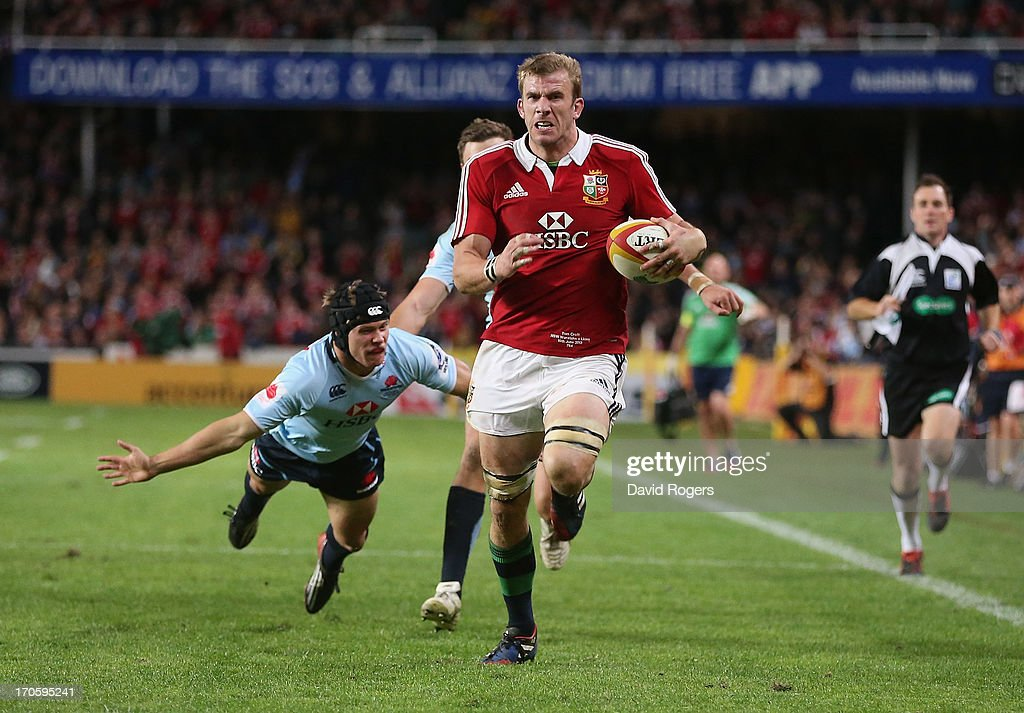 <a gi-track='captionPersonalityLinkClicked' href=/galleries/search?phrase=Tom+Croft&family=editorial&specificpeople=672626 ng-click='$event.stopPropagation()'>Tom Croft</a> of the Lions breaks clear to score a try during the match between the NSW Waratahs and the British & Irish Lions at Allianz Stadium on June 15, 2013 in Sydney, Australia.