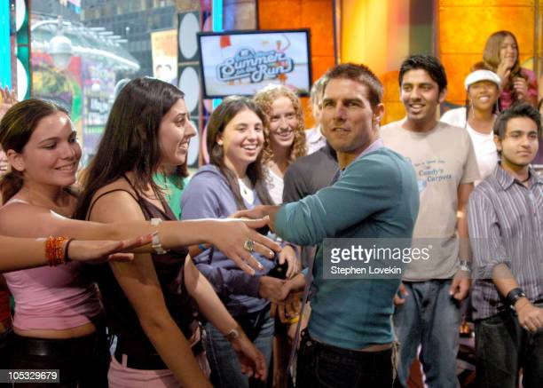Tom Cruise and audience during Tom Cruise Jamie Foxx and Jada Pinkett Smith Visit MTV's 'TRL' August 5 2004 at MTV Studios in New York City New York...
