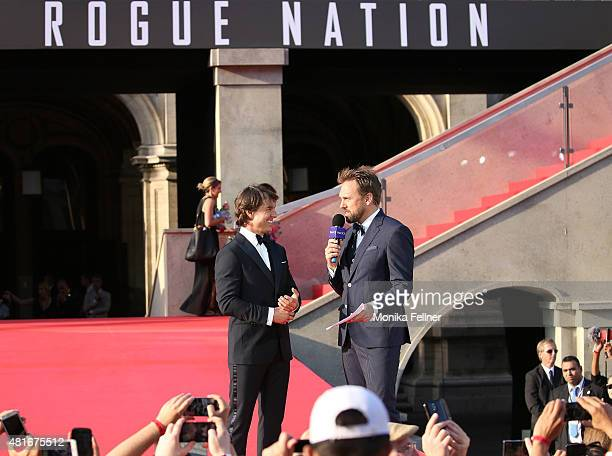 Tom Cruise and Host Steven Gaetjen speak on stage during the world premiere of 'Mission Impossible Rogue Nation' at the Opera House on July 23 2015...