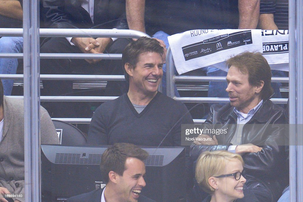 Tom Cruise (L) and Jerry Bruckheimer attend an NHL playoff game between the San Jose Sharks and the Los Angeles Kings at Staples Center on May 23, 2013 in Los Angeles, California.