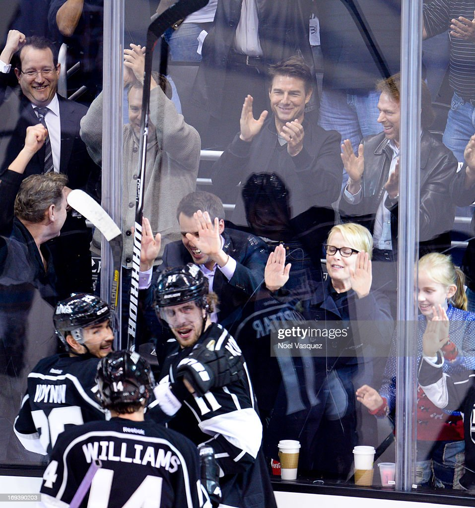 Tom Cruise (L) and Jerry Bruckheimer attend an NHL playoff game betweent he San Jose Sharks and the Los Angeles Kings at Staples Center on May 23, 2013 in Los Angeles, California.
