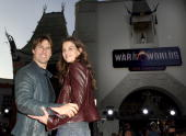 Tom Cruise and Katie Holmes during 'War of the Worlds' Los Angeles Fan Screening Red Carpet at Grauman's Chinese Theatre in Hollywood California...