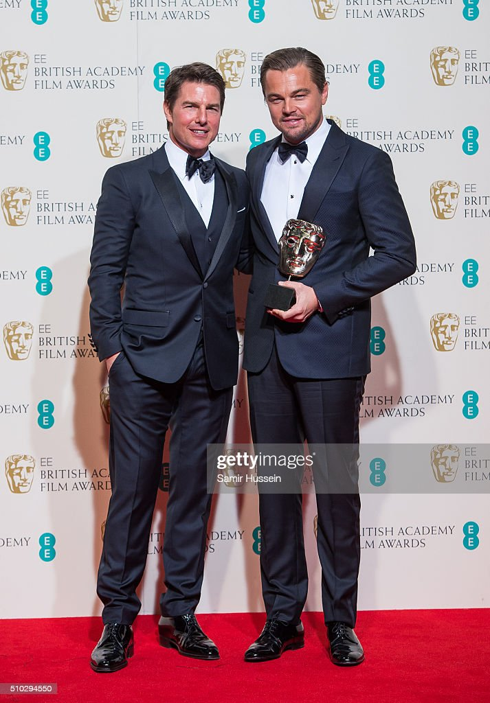 Tom Cruise and Leonardo DiCaprio pose in the winners room at the EE British Academy Film Awards at The Royal Opera House on February 14, 2016 in London, England.