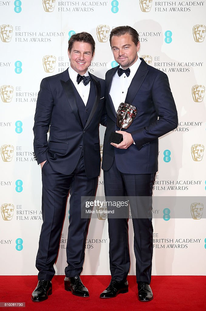 Tom Cruise (L) and Leonardo DiCaprio, winner of the Best Actor award for 'The Revenant', pose in the winners room at the EE British Academy Film Awards at The Royal Opera House on February 14, 2016 in London, England.
