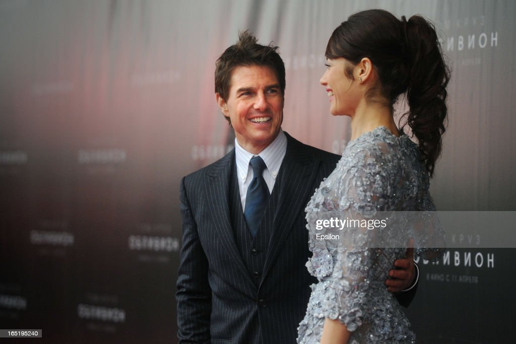 Tom Cruise and Olga Kurylenko attend the film premiere of 'Oblivion' at the Oktyabr cinema hall on April 1, 2013 in Moscow, Russia.