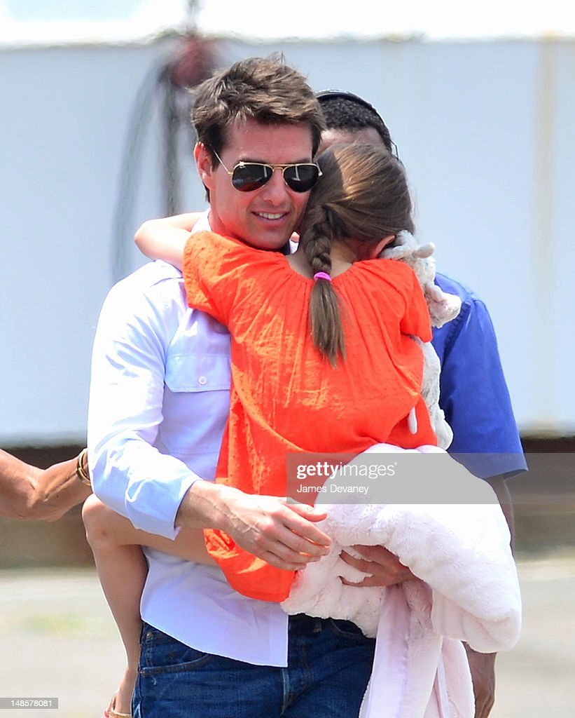 <a gi-track='captionPersonalityLinkClicked' href=/galleries/search?phrase=Tom+Cruise&family=editorial&specificpeople=156405 ng-click='$event.stopPropagation()'>Tom Cruise</a> and <a gi-track='captionPersonalityLinkClicked' href=/galleries/search?phrase=Suri+Cruise&family=editorial&specificpeople=4029470 ng-click='$event.stopPropagation()'>Suri Cruise</a> leave Manhattan by helicopter at the West Side Heliport on July 18, 2012 in New York City.
