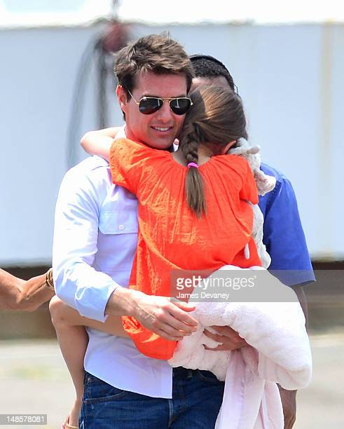 Tom Cruise and Suri Cruise leave Manhattan by helicopter at the West Side Heliport on July 18 2012 in New York City