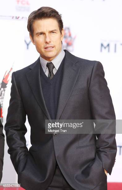 Tom Cruise attends the hand and footprint ceremony honoring Ben Stiller held at TCL Chinese Theatre on December 3 2013 in Hollywood California
