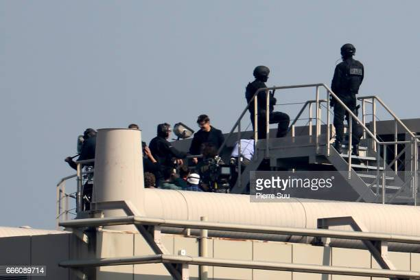 Tom Cruise is seen on the set of Mission Impossible 6 on the rooftop of the french ministry of finance on April 8 2017 in Paris France