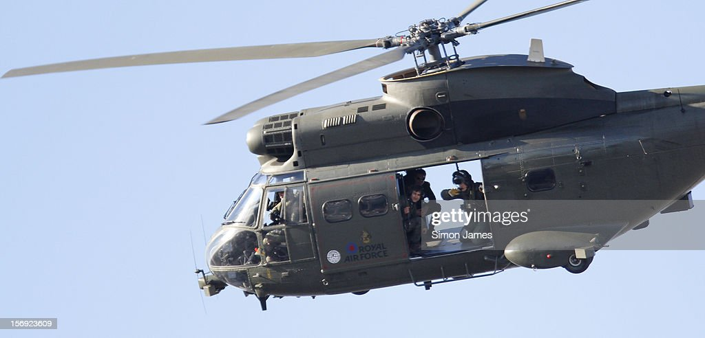 Tom Cruise (Rear) is sighted flying in and RAF helicopter on set for the movie 'All You Need Is Kill' being filmed in Trafalgar Square on November 25, 2012 in London, England.