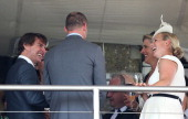 Tom Cruise jokes with Zara Phillips at Glorious Goodwood Ladies Day at Goodwood on July 31 2014 in Chichester England