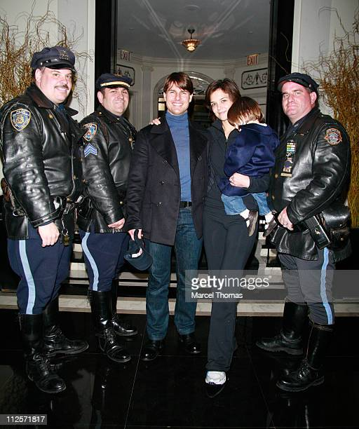 Tom Cruise Katie Holmes and Suri Cruise pose with NYPD Highway Patrol officers at their hotel while returning from the New York City Marathon on...