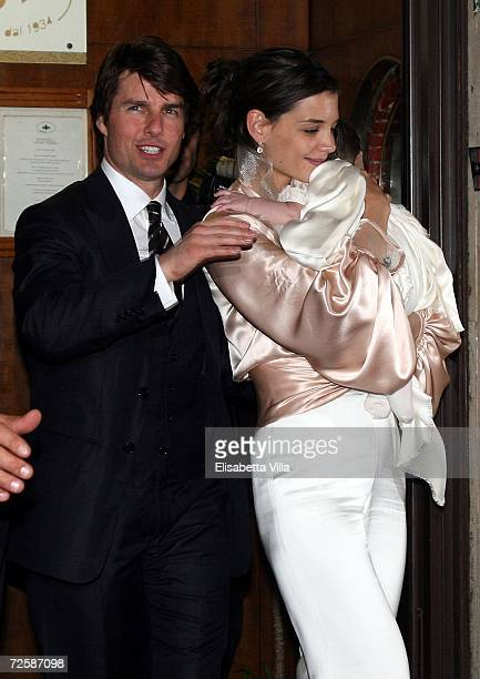 Tom Cruise Katie Holmes and their daughter Suri leave the restaurant in central Rome as part of Katie Holmes and Tom Cruise wedding expected at...