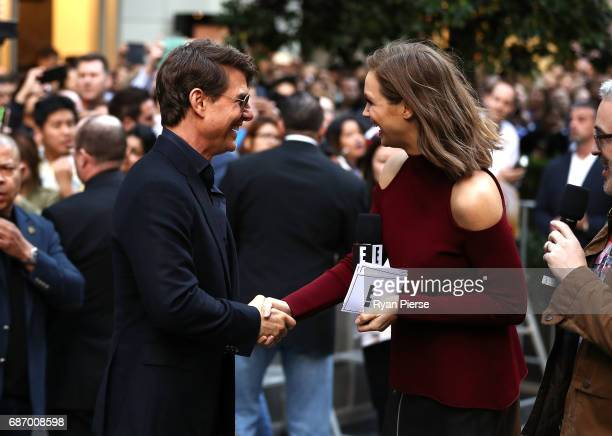 Tom Cruise meets Ksenija Lukich during a photo call for The Mummy at World Square on May 23 2017 in Sydney Australia