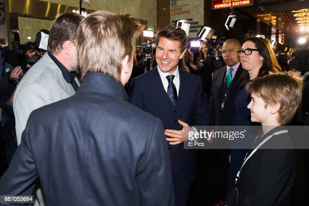 Tom Cruise meets Russell Crowes children on the black carpet as he arrives ahead of The Mummy Australian Premiere at State Theatre on May 22 2017 in...
