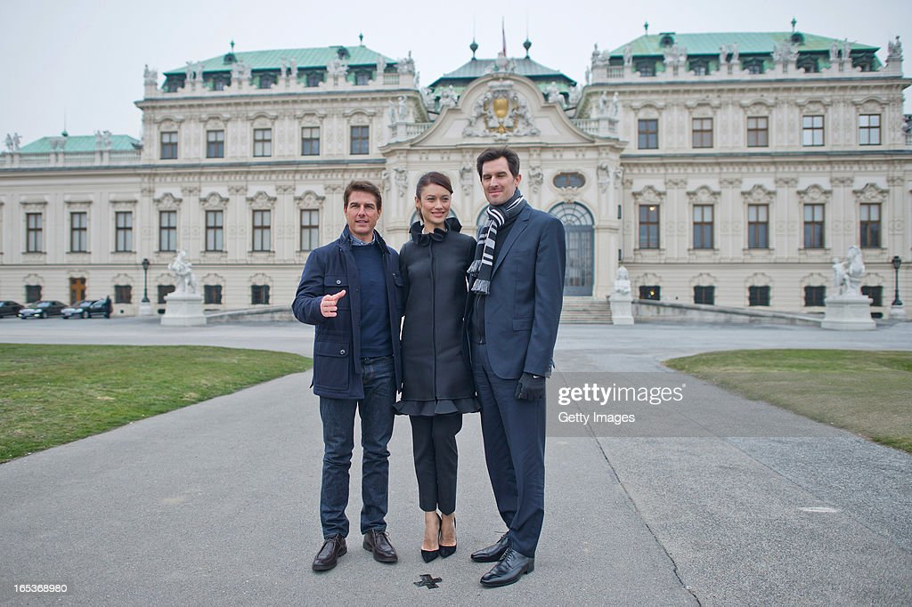 Tom Cruise (L), Olga Kurylenko and Joseph Kosinski attend a photo call for the film 'Oblivion' at Belvedere Palace on April 2, 2013 in Vienna, Austria.
