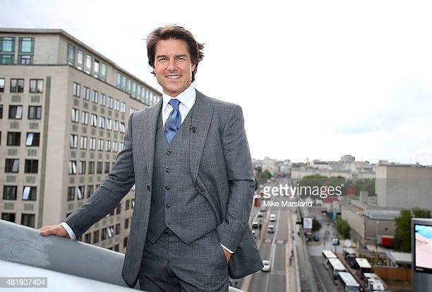 Tom Cruise on the roof of the IMAX cinema as he attends the UK Fan Screening of 'Mission Impossible Rogue Nation' at the IMAX Waterloo on July 25...