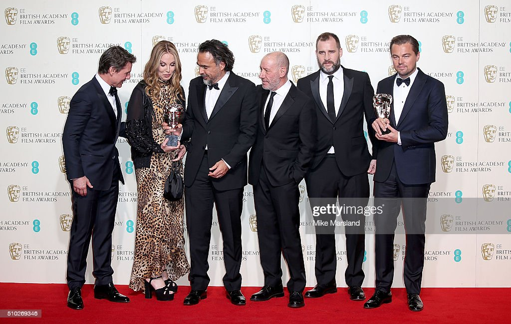 Tom Cruise poses with Best Film winners Mary Parent, Alejandro Gonzalez Inarritu, Steve Golin, Keith Redmon and Best Actor winner Leonardo DiCaprio for 'The Revenant' in the winners room at the EE British Academy Film Awards at The Royal Opera House on February 14, 2016 in London, England.