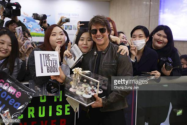 Tom Cruise poses with fans as he arrives in South Korea to attend Paramount Pictures' 'Jack Reacher Never Go Back' Seoul Premiere on November 7 2016...
